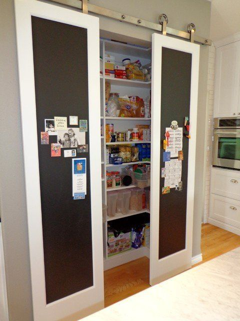 Sliding pantry door with chalkboard face - slimmer door profile PLUS space to display and/or write stuff on the wall. So useful