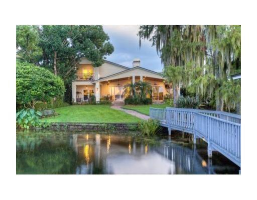 Love the bridge and lake surrounding this dream home