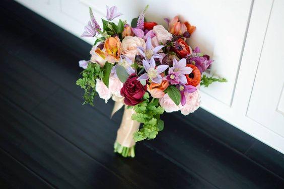 Gorgeous bridesmaid's bouquet. #bouquets #bridesmaids #tulip #gardenrose #clematis #ranunculus #vibrantflowers