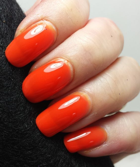 """This polish packs a punch!A bright orange jelly polish that's so bright and eye catching that I had to name it Kapow! One of my favorite terms for bright polishes that you just think """"wow"""" when you see it. So I couldn't stop at just Kapow...it became Kapow Wow!I LOVE this one, I hope you do as well.Second photo shows three coats with a top coat added to add to the wow factor of this color."""