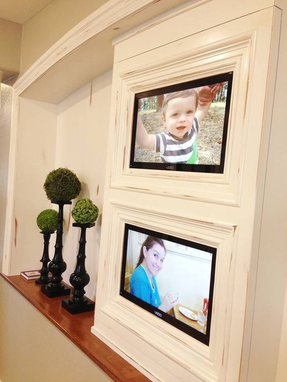 Becky Higgins [from Project Life]: Large screens with digital images in her home