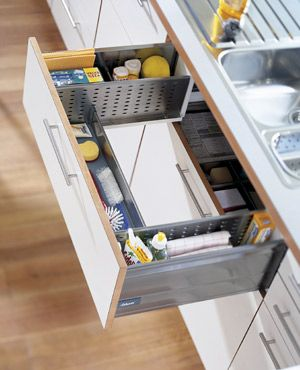 A drawer that wraps around the sink to hold essential cleaning supplies at-hand