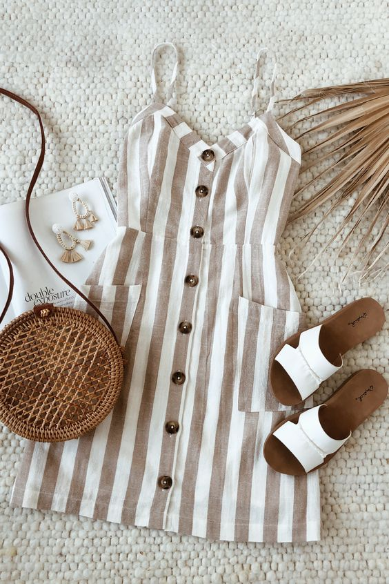 Summer's favorite striped beige sundress is here. Picture yourself soaking up the sun in this beach day look. Style with white sandals and a woven bag for a classic summer outfit. #lovelulus