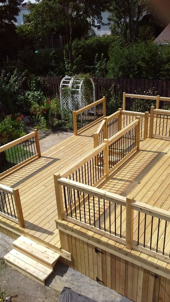 Two level deck deck with porch-style railing and skirting