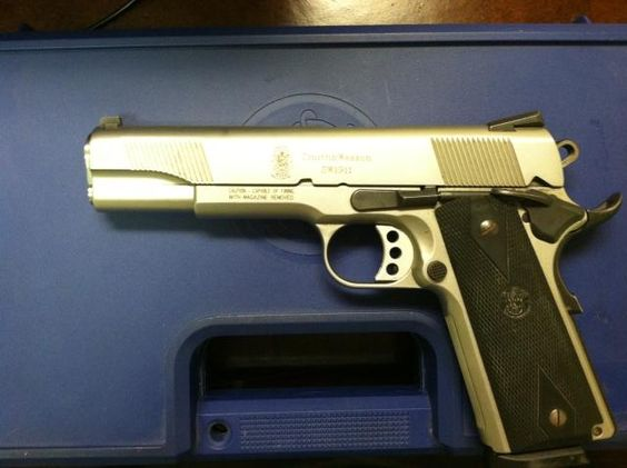 Smith and Wesson 1911, fully automatic, .45 caliber $8,500