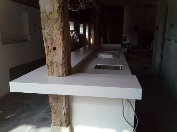 Fitting seamless worktops around old oak beam?