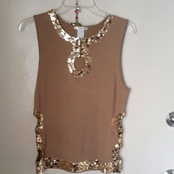 Super sexy top. Sequence. Holiday wear Sexy cut out sides and pika boo chest cut out. Wore it once only. In perfect condition. frost Tops