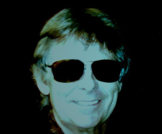 Gary Revel wearing sunglasses in the dark.