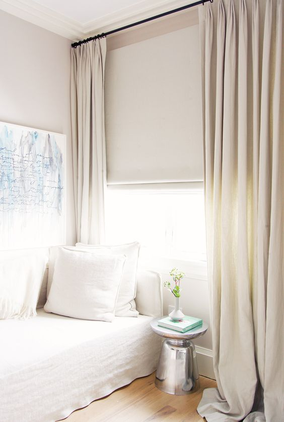 Neutral curtains in white bedroom.
