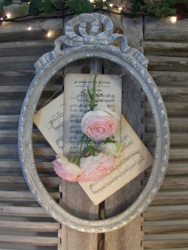 old frame, sheet music and roses hung on an old shutter...lovely