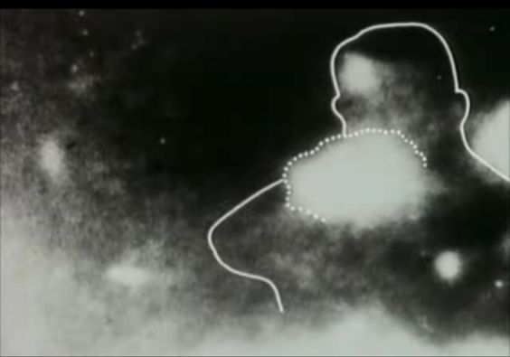 JFK's killer? Shadowy image of 'the badge-man' (with added outline) suggesting a man with a badge firing a rifle, as taken by Mary Moorman at the moment the fatal shot was fired. She was standing on the opposite side of Elm Street from Zapruder, facing the grassy knoll.