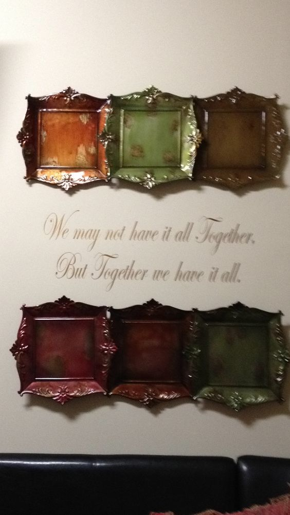 My kitchen wall.. We may not have it all together but together we have it all!! Family Motto! ....Vinyl from Flea Market vendor $10.00