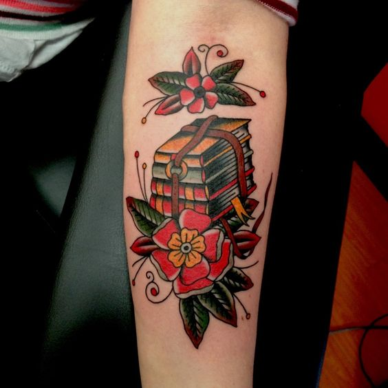 Love the theme of this tattoo! You don't see books tattooed very often! Artist: ?. #neotraditional