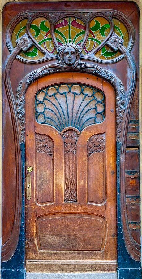 carved wood door, art nouveau, stained glass, iron work