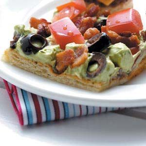 Guacamole Appetizer Squares   Crescent rolls, Bacon. Avocado, Olives, Cream Cheese, Plum Tomatoes