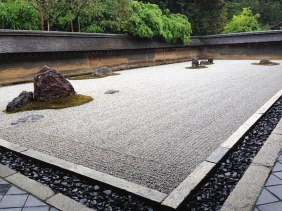 Ryoanji temple under the spring rain. Ryoan-ji (The Temple of the Dragon at Peace) is a Zen temple located in northwest Kyoto, Japan. In 1450, Hosokawa Katsumoto, another powerful warlord, acquired the land where the temple stood. He built his residence there, and founded a Zen temple, Ryoan-ji. During the Onin War between the clans, the temple was destroyed. Hosokawa Katsumoto died in 1473. In 1488, his son, Hosokawa Matsumoto, rebuilt the temple.