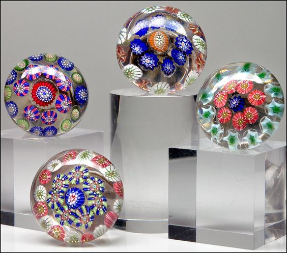 I collect paperweights and my favorite kind are doorknobs (mostly Perthshire and Strathearn). These are incredible ones reputed to be by St. Louis on eBay. WOWZER