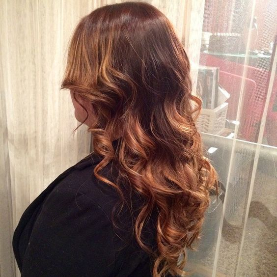 Dark copper & beige tones create a deep #auburn base color, with caramel #ombre highlights by Jocelyn. Love!  #readyforspring #bigcurls #hairstylist #goldwellcolor #caramelhighlights #haircolor #colorexpert #jungleredsalon #minneapolis
