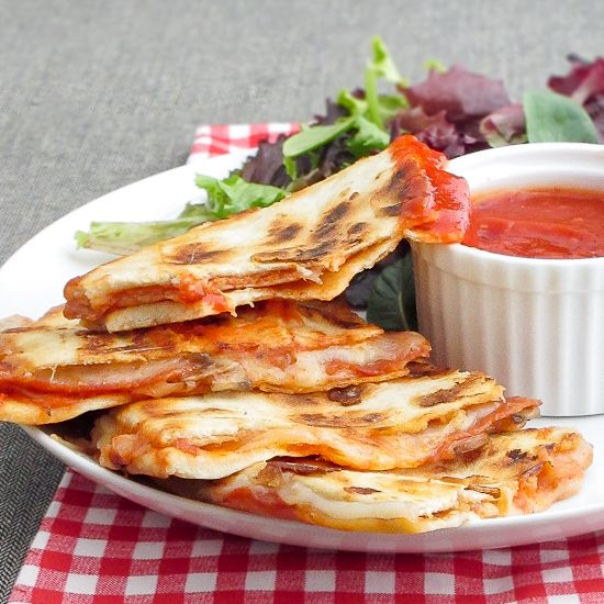 Pepperoni Pizza Quesadillas. AKA my new favorite food. Simple and yet genius. It makes me wonder how I never thought of it. Make it with corn tortillas instead of flour tortillas. :) Yum yum yum