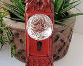 Aqua- Vintage-Inspired Decorative Cast Iron Door Plate with Key Hole and Glass Knob. $17.95, via Etsy.