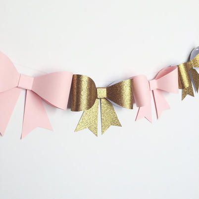 handcrafted pink bow garland is made of specialty paper and premium card stock.  7 beautiful handcrafted bows are strung on clear string and can easily be moved. Each bow is ...