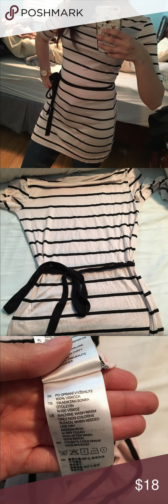 H&M pink and black striped tunic New without tags.  It's a really beautiful tunic with almost a sheen to the fabric that is not too visible in photos. I never wore it because I felt the color wasn't super flattering on me, but I could see it being perfect on someone else. Comes with a sash around the waist; body-hugging design with minimal stretch. H&M Tops Tunics