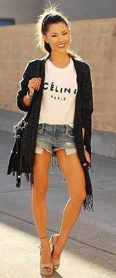 t-shirt, denim cutoffs and black fringed cover-up
