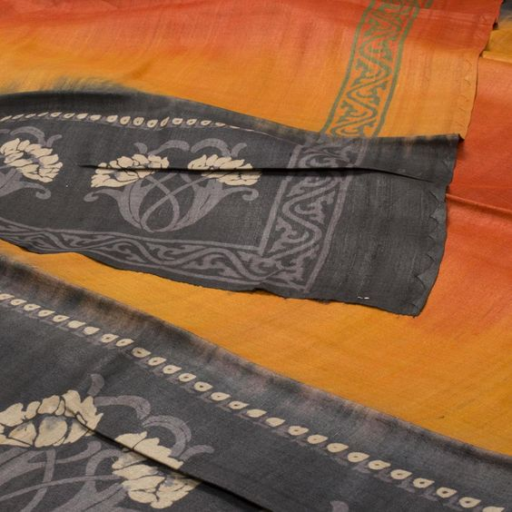 "The ""#Orange"" #handblock #Printed #Tussar #Silk #Sari from Weavers Studio that is set off by printed floral motifs in black border on either side. The border is repeated on the orange blouse that completes the sari."