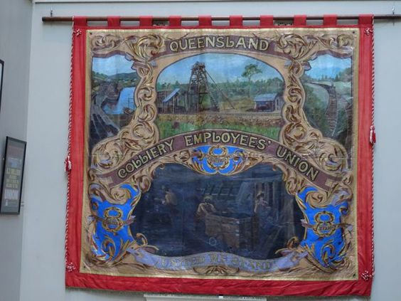 Qld Colliery Employees banner from early 20th century, on display as part of centenary of the federating of the mining unions 1915-2015 at Sydney Trades Hall