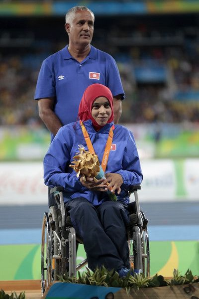 Maroua Brahmi of Tunisia poses on the medals podium after winning the Women's…