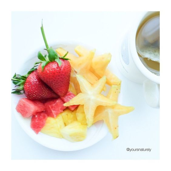 Fruit bowl Thursday with pineapples, watermelon, starfruits and strawberries with a side of green tea