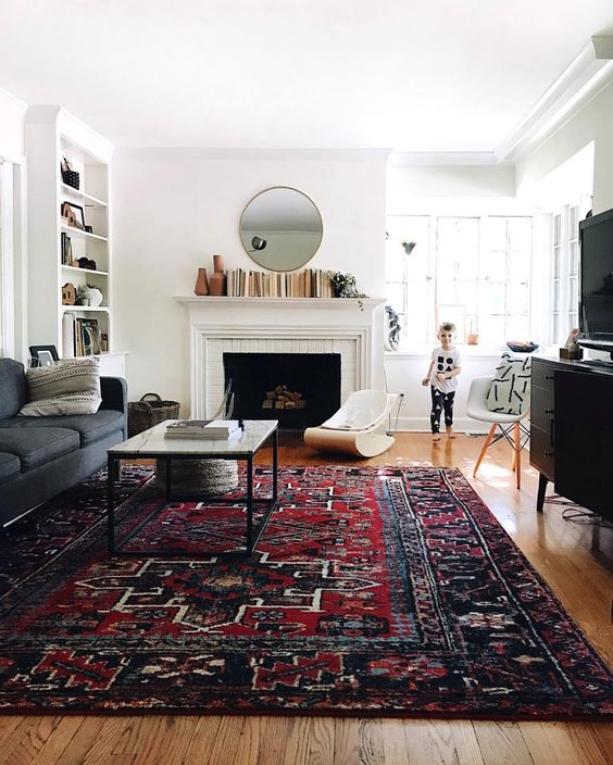 Love this living room and bold rug.