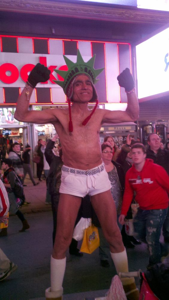 I saw this guy in time square you heard of the naked cowboy well this is the naked statue of liberty