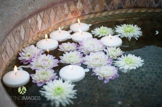Flowers and candles floating together in the fountain | Lasting Images Photography | villasiena.cc
