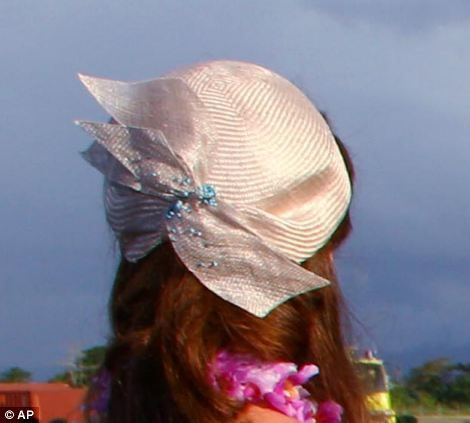 Fashion lover: Kate wore a bespoke cocktail hat by Jane Taylor pinned to her curls at the back of her head