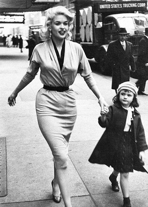 Jayne Mansfield walks her daughter, Jayne Marie Mansfield, along a sidewalk in Midtown, New York, New York, late 1955