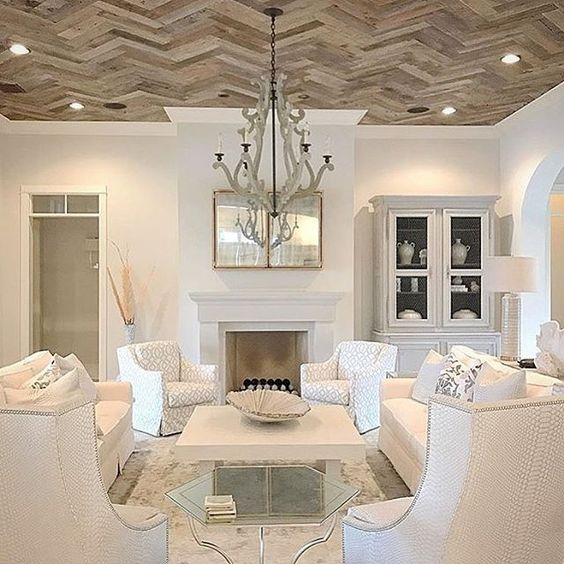 All white living room with dramatic herringbone wood ceiling. Beautiful Classically Refined Rooms.