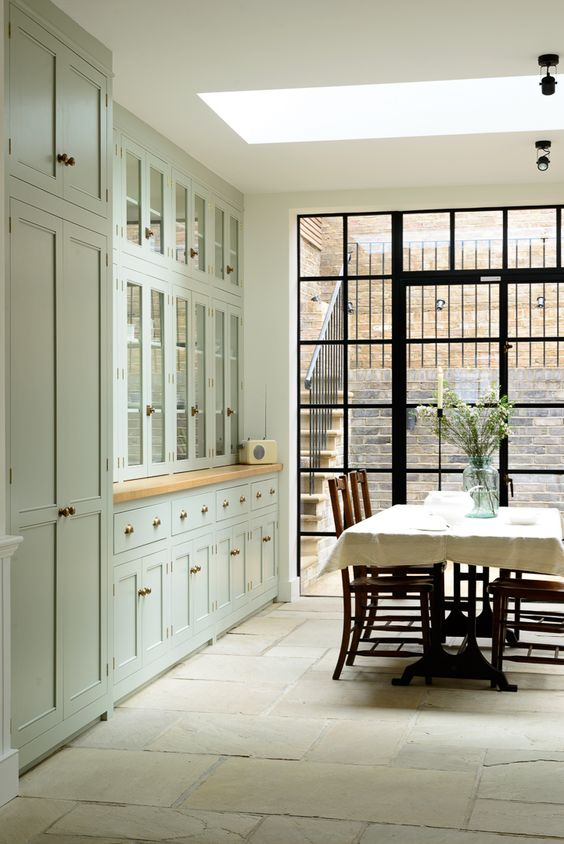 A whole wall of beautiful cupboards from deVOL's Classic English kitchen range, and tall crittall windows