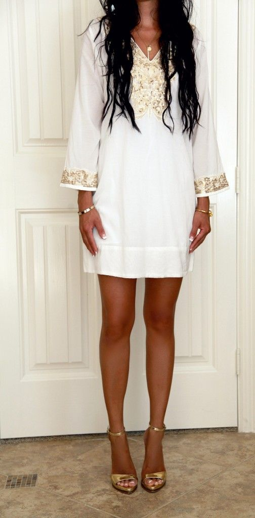 Great white linen outfit idea via the haute cookie. Tip: white and gold pair perfectly - accessorize your white linen outfits this summer with gold shoes & jewelry!