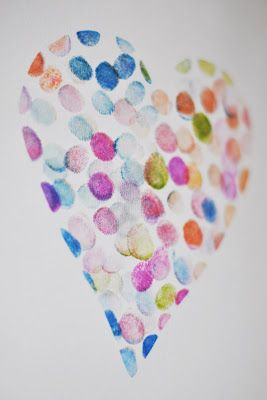 Thumb Print Art - cut out the shape you want to make a stencil, then use stamps for finger printing inside the stencil