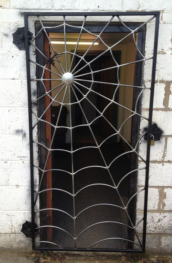 "Cool! You can get a spider web gate custom made by ""Art of Metal"" in the UK. £480.00"