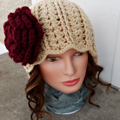 Jennifer Rose is a beautiful hand crocheted cloche that will keep you warm while staying stylish! The Lovely rose brooch can be re-positioned or taken off and worn on your coat, blouse, or anything else you would like  Made from 100% acrylic yarn in Buff/Beige. Measures approx 22 inches around ...