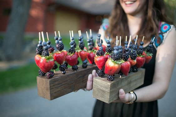 Fruit Skewers Step up a basic fruit platter by serving a variety of fresh berries on skewers and displayed on wood serving blocks.