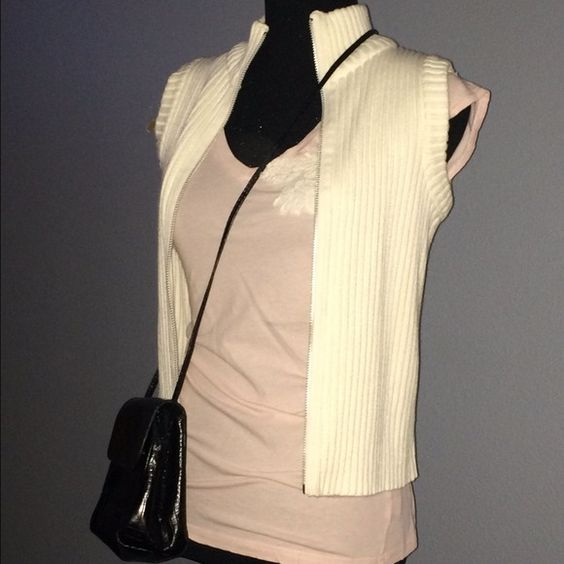 Chunky Sweater Vest w/ 2-Way Zipper  100% Cotton, Cream, Ribbed knit sweater vest with unique two-way zipper from the Gap, NWOT. Sz small but fits a med nicely.  Just a reminder, I include a quality, customized FREE gift w/ every purchase, no matter how big or small! (Value $5-$15) GAP Sweaters Cardigans