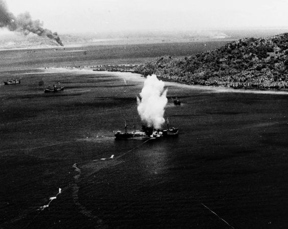 The Japanese freighter Amagisan Maruis hit by a torpedo dropped by pilot Lt. Paul Eugene Dickson from a TBF Avenger torpedo bomberduring Operation Hailstone,   a massive naval air and surface attack launched by the US Navy against the Japanese naval base in the Caroline Islands. February 17, 1944. Photo by W. Eugene Smith. [x]