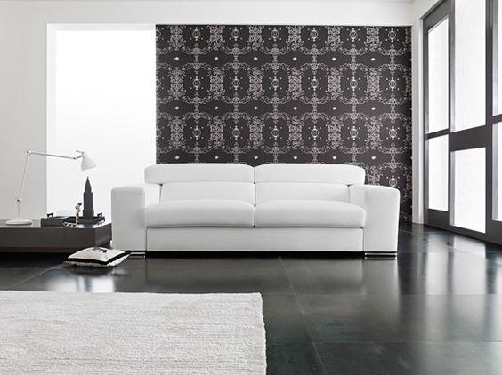 Divano 3 posti moderno con poggiatesta reclinabile in pelle bianca.
