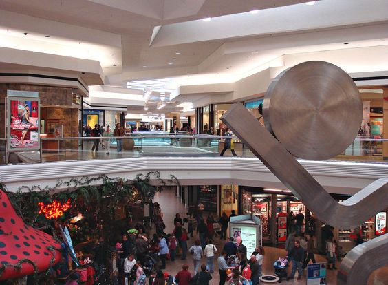 """A familiar view looking from upper level macy*s onto Westfarms stretching corridor in early 2007. Developers at Taubman promised guests could see one end of the mall from the other, which would be original anchor JCPenney in the distance. Buky Schwartz's """"Hope"""" sculpture is still there though Rainforest Cafe closed in 2013 and Hannoush Jewelers has since remodeled."""