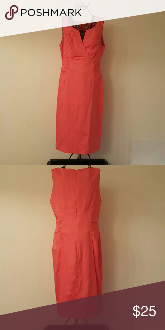 Beautiful Coral Dress Coral midi dress perfect for Business, Dinner, Wedding etc. Can be dressed up or dressed down. New.  Never worn but tags fell off in closet shuffle. Smoke-free home. Ready to wear. London Times Dresses Midi