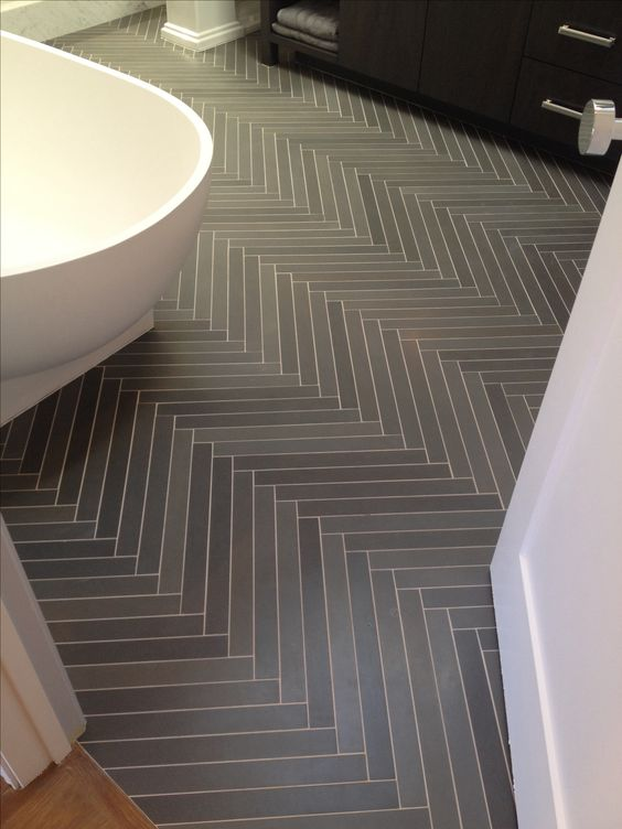 Amazing herringbone slate tile treatment in bath