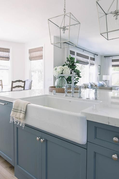 A Shaw Farm Sink Paired With A Chrome Hook And Spout Faucet Is